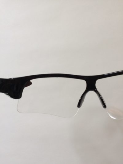 Looking through lens of bicycling sunglasses.