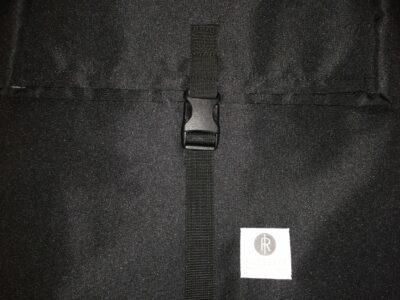 Ridgebake Postal 2 Backpack logo made from reflective material.
