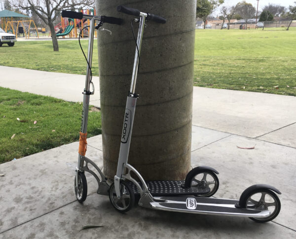 Taking a ride on Xootr Scooters.