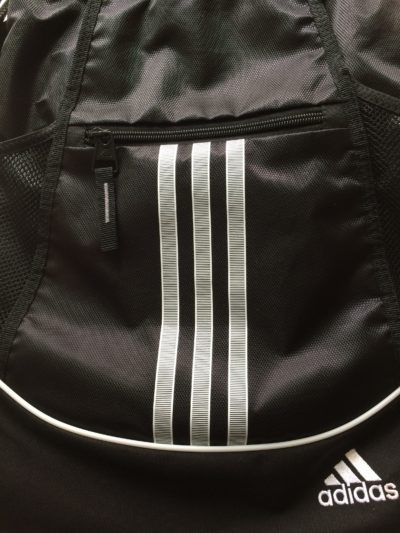 Adidas cinch sack with multiple pockets in front and sides, made out of a water resistant material.