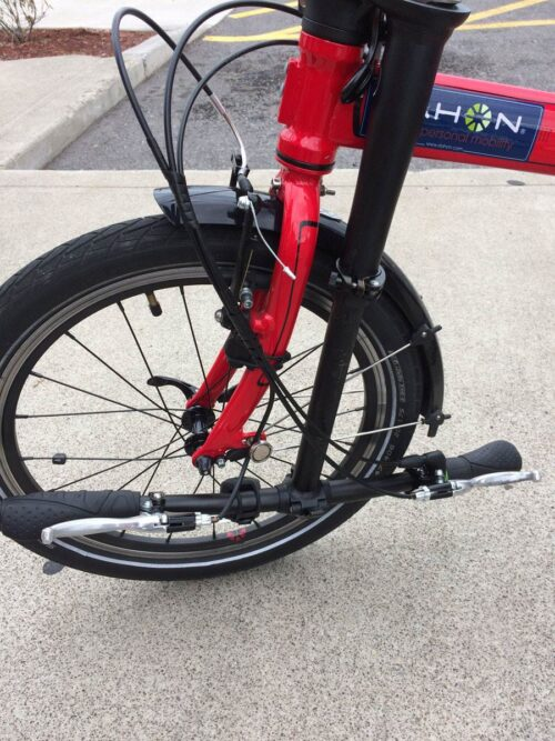 Handlebars fold down and get neatly tucked between frame while folded.