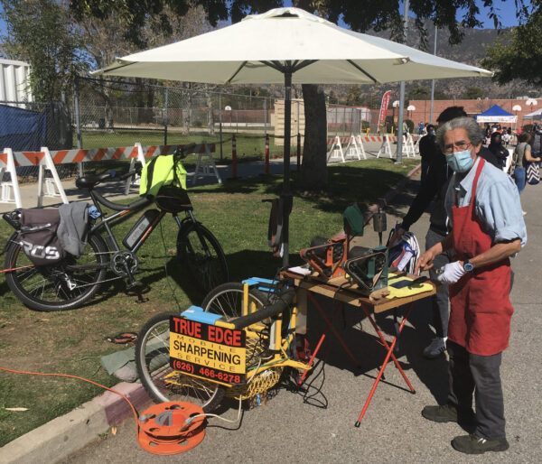 Ten miles from home to work, on a RadCity 4 Electric Commuter Bike, towing the tools of his trade in a two-wheeled cargo trailer.