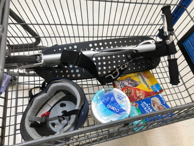 The Xootr Mg scooter along with cat treats and other stuff from the grocery store, all neatly placed in the cart. Such a great way to end this Xootr scooter grocery shopping adventure.