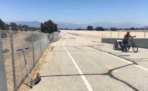 Bike path with chain link fence.
