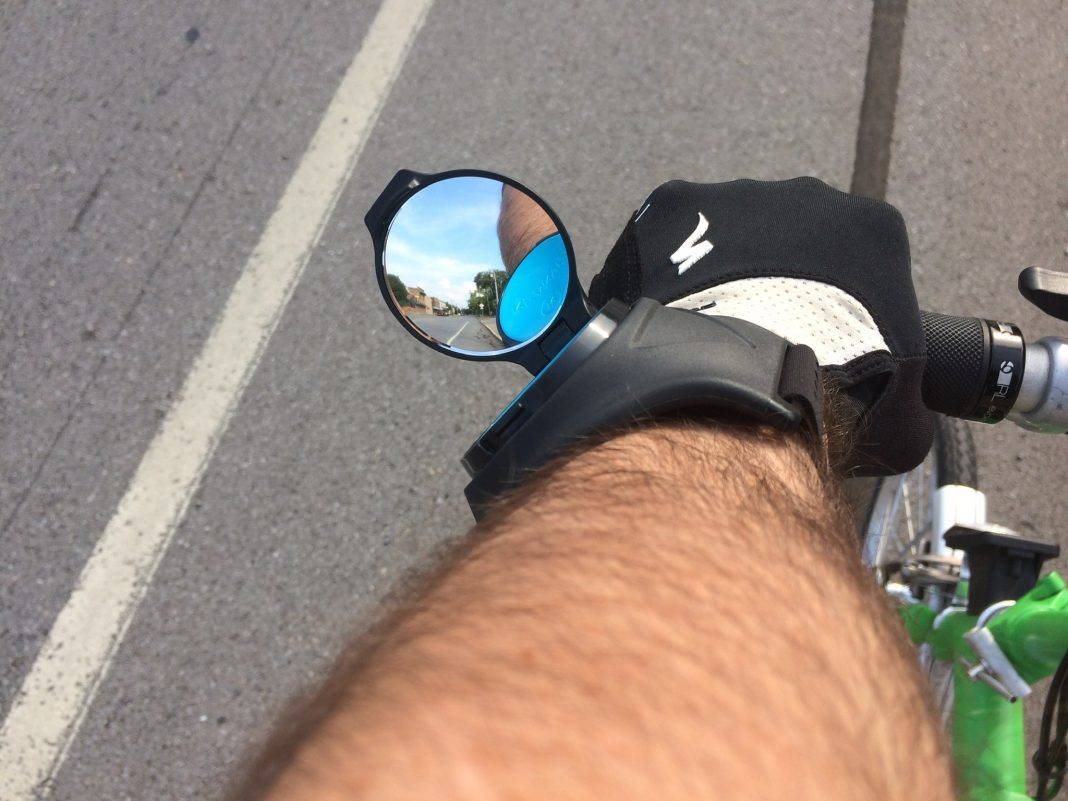 Riding with the RearViz Classic bike mirror strapped to my arm.