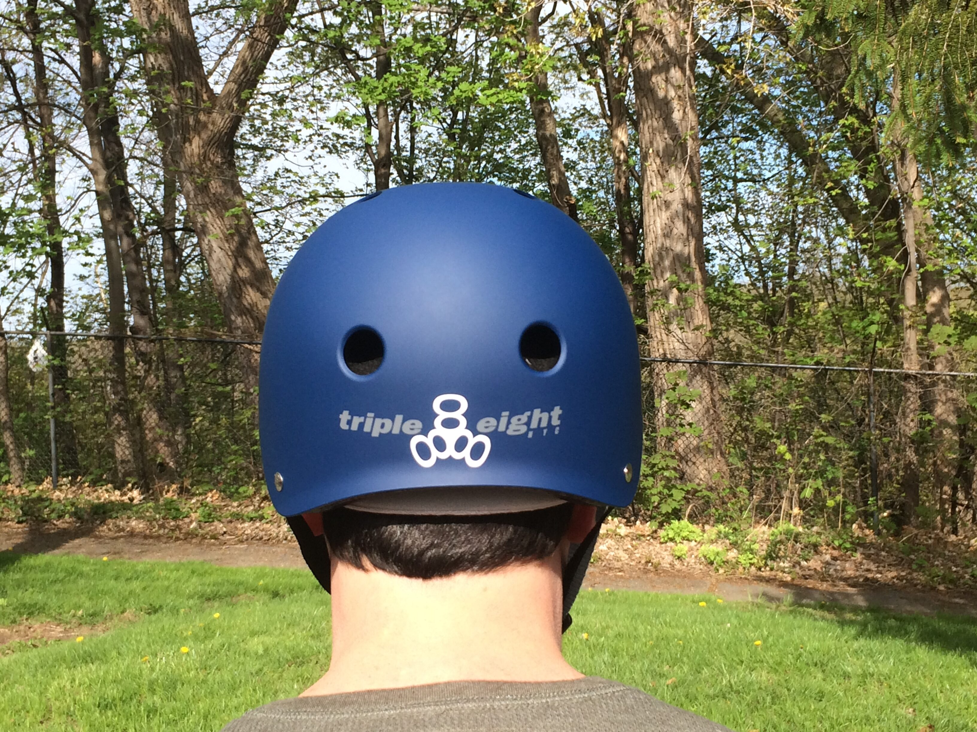 Triple Eight Certified Sweatsaver helmet doesn't dig into the back of my neck, because of the curved lip and lack of an adjustment knob. It also features the name of the helmet with a reflective logo.