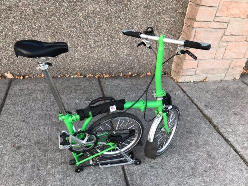 "Brompton folding bike in ""Park Mode."""