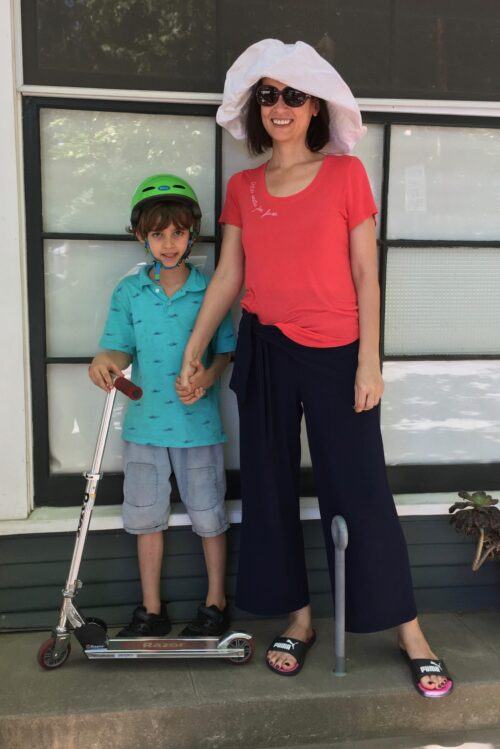 Jonathan Kelley's neighbor, with son on a kick scooter.