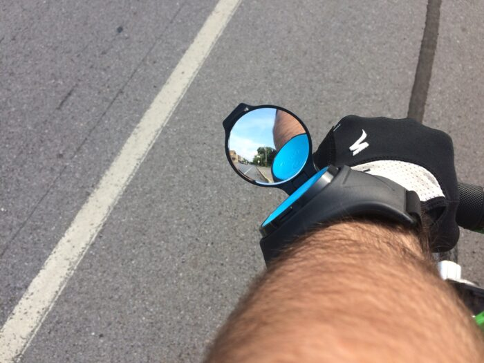 I found the RearViz Classic bike mirror worked best 4-5 inches above my wrist. And rotated to around the 10 O'Clock position.