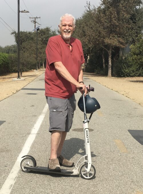Riding the Xootr Scooter.