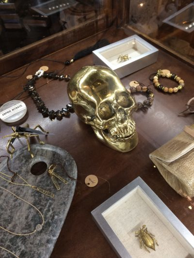 Big gold colored skull on top of table.