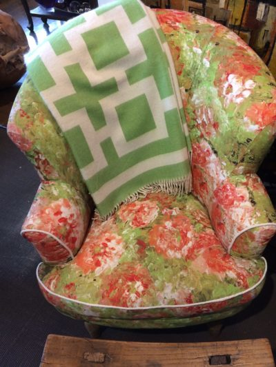 Colorful chair with green and white blanket.