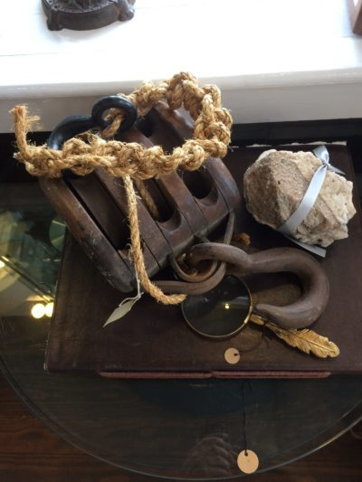Old fashioned pulley with hook and rope.