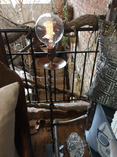 Hand welded floor lamp with old fashioned bulb at Arena's.